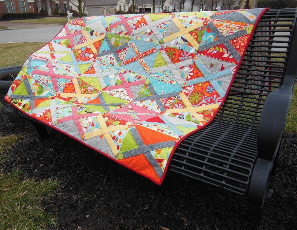 treasure map quilt by sharon mcconnell, modern patchwork cross block with bright colors