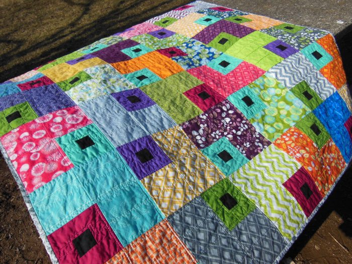 Jewel Box quilt by Color Girl, modern quilting with layer cake fabric