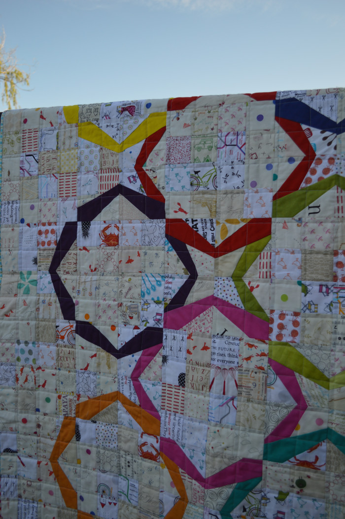 Modern ring quilt, patchwork, low volume pieced quilt with bright color solid fabric rings paper foundation piecing, by sharon mcconnell for color girl quilts