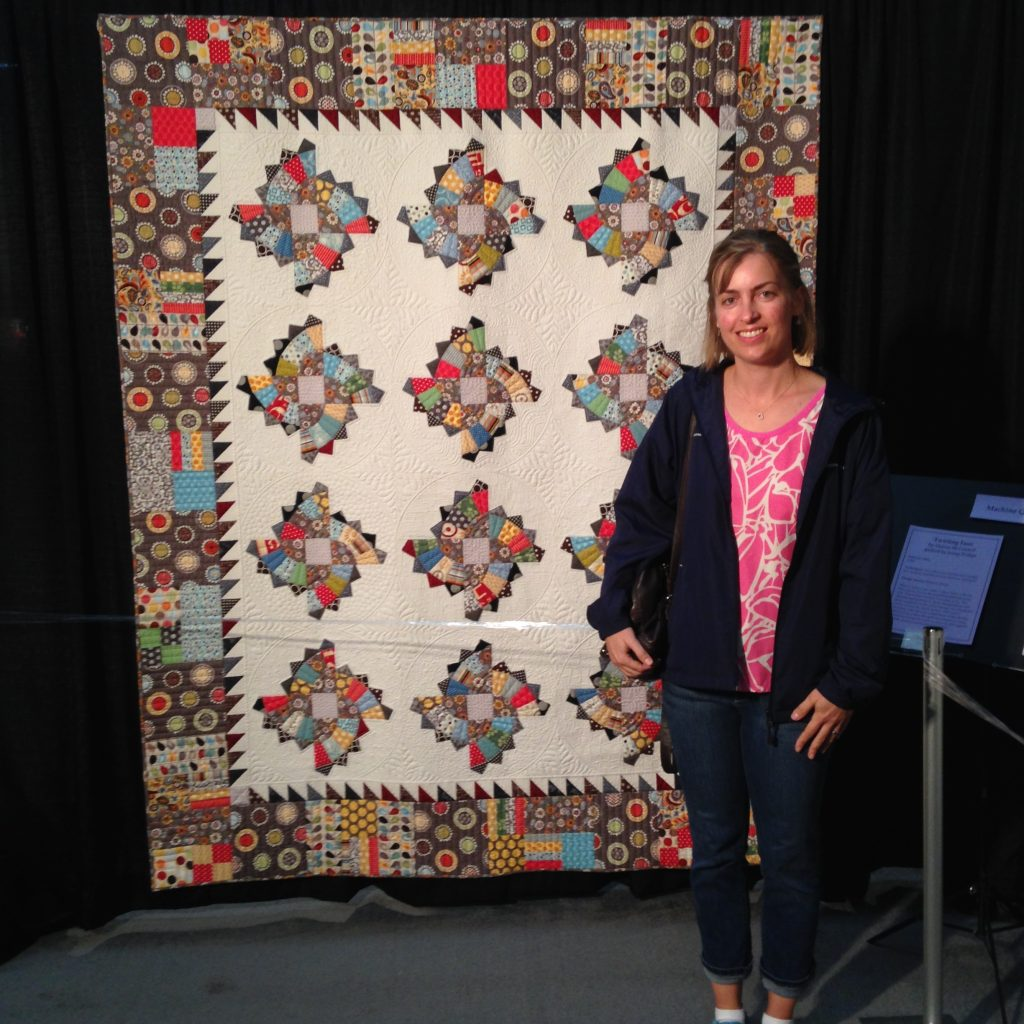 Twirling Fans Quilt at Quilt, Knit, Stitch show by Quilts, inc, MQX show portland oregon