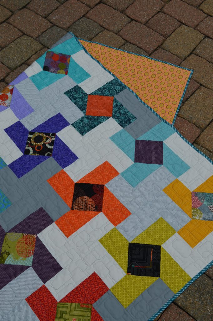 Dutch Windmill Quilt by Sharon McConnell for Color Girl Quilts, modern patchwork, charm quilt