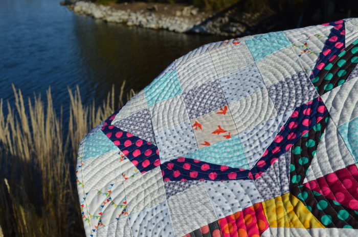 Hula Girl Quilt by Sharon McConnell, low volume, polka dot patchwork ring quilt