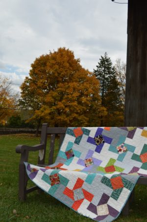 Dutch Windmill quilt by Sharon McConnell, color girl quilts, modern patchwork, pinwheel quilt with scraps