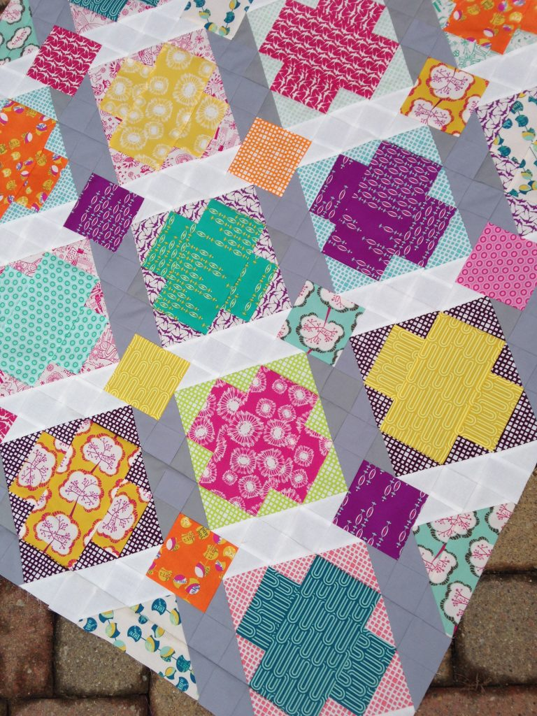Utopia quilt, art gallery fabrics, modern patchwork cross quilt