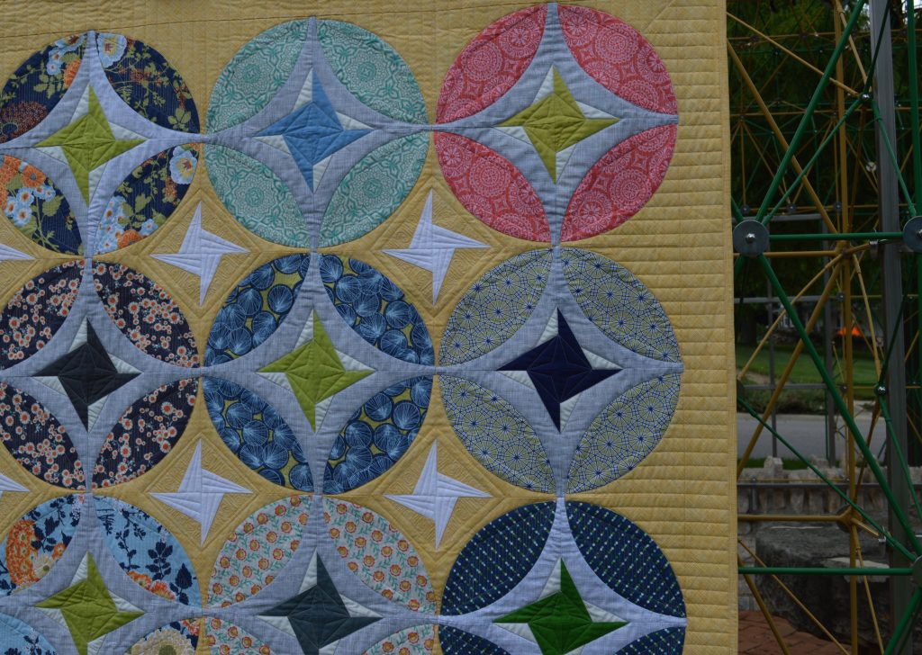 Eclipse quilt by Sharon McConnell, curved piecing orange peel quit design with stars
