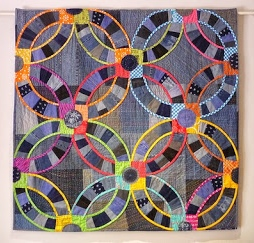 modern wedding ring quilt with denim fabric, bright colors, ring quilt