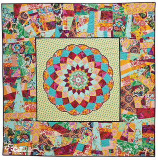 modern quilt with pieced medallion and scrappy border fabrics