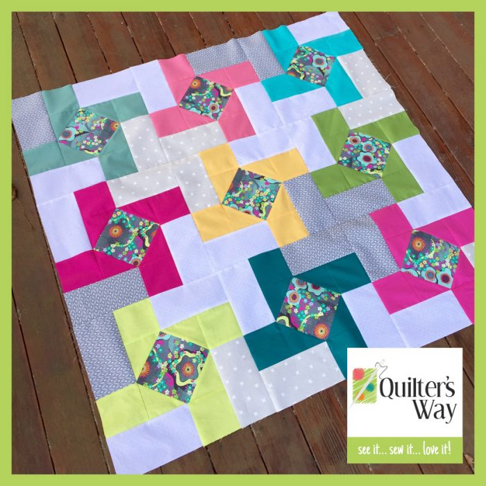 Dutch Windmill modern patchwork baby quilt with solid fabrics and scraps
