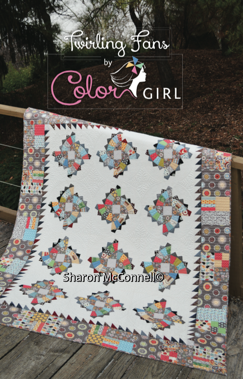 modern traditional fan quilt pattern by Color girl quilts, scrap quilt with borders
