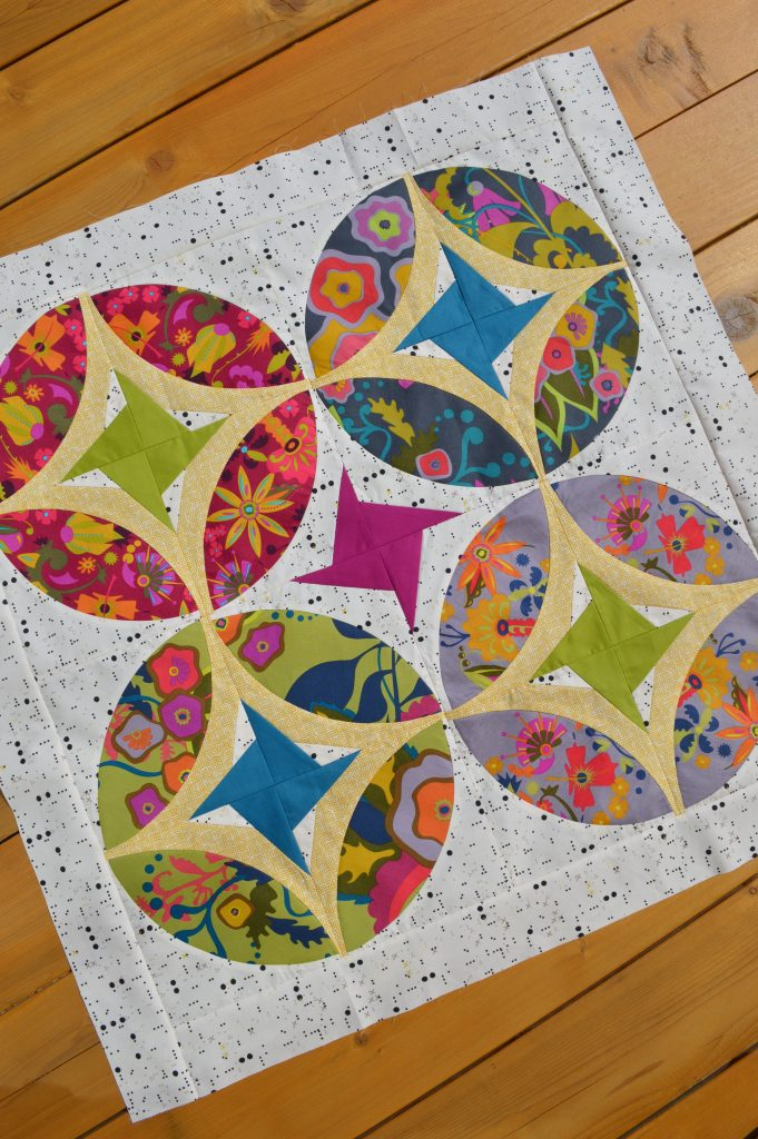 Eclipse quilt pattern, mini quilt table topper wallhanging, patchwork with stars and curved piecing