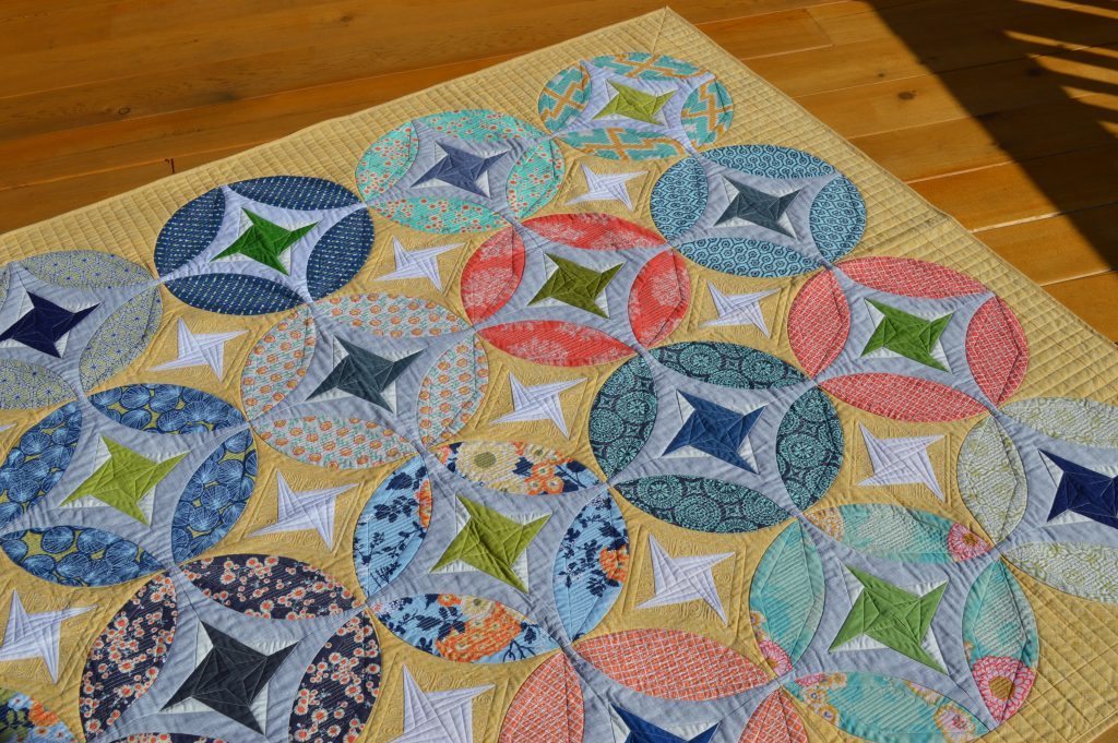 Eclipse quilt by Color Girl, patchwork quilt pattern with curved piecing and stars
