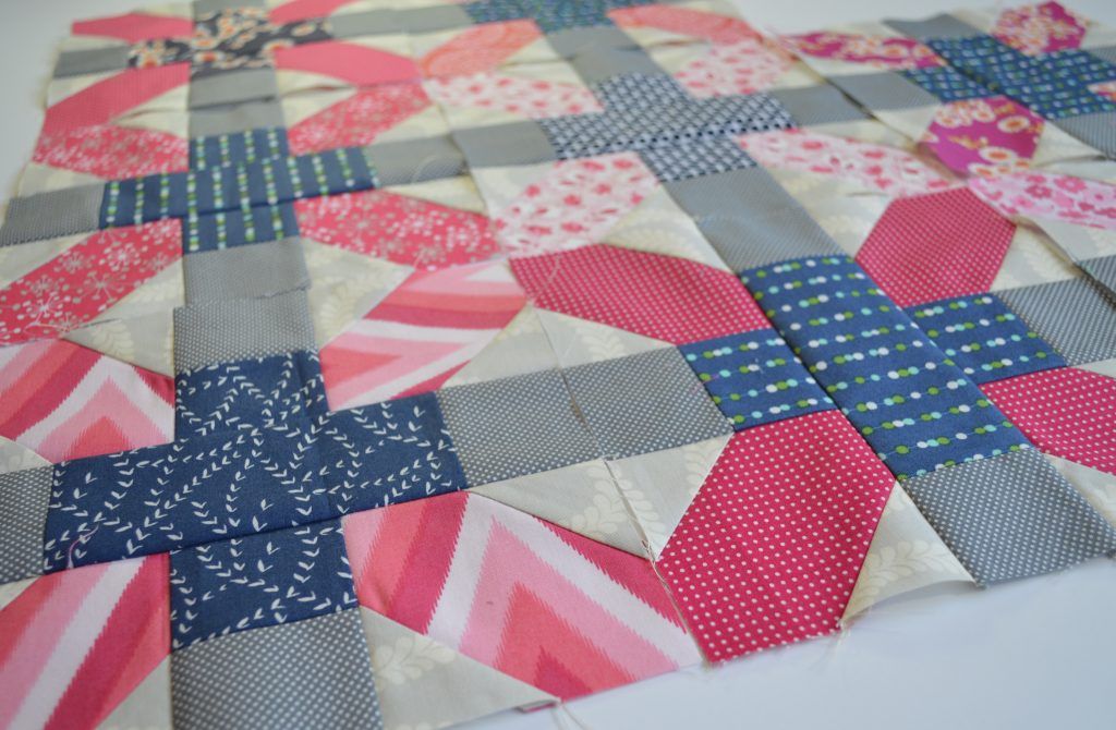 Aviatrix medallion patchwork quilt with scrappy x and plus blocks