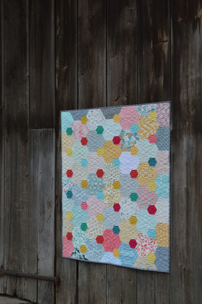 Pops hexagon patchwork quilt by Sharon McConnell, featured in Quilt Now Magazine