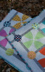Whimsy Garden quilt by Sharon McConnell, modern scrappy patchwork with curved piecing and appliqué
