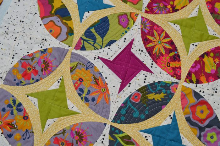 Eclipse quilt, curved piecing mini quilt by Sharon McConnell