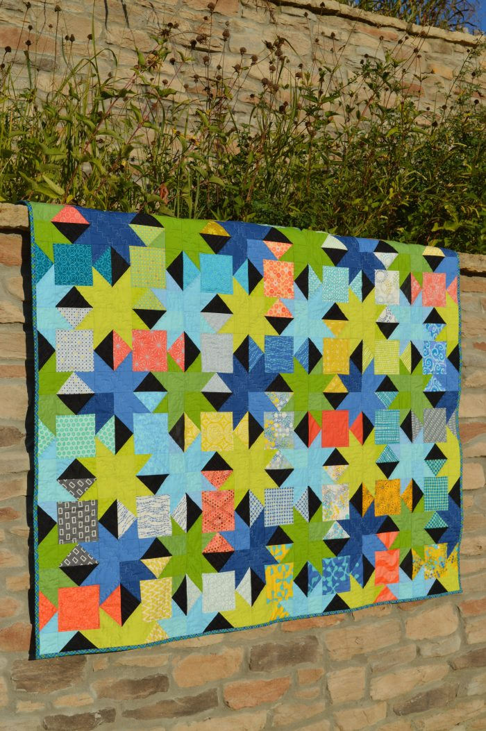 Sparkle charm square quilt by Sharon McConnell