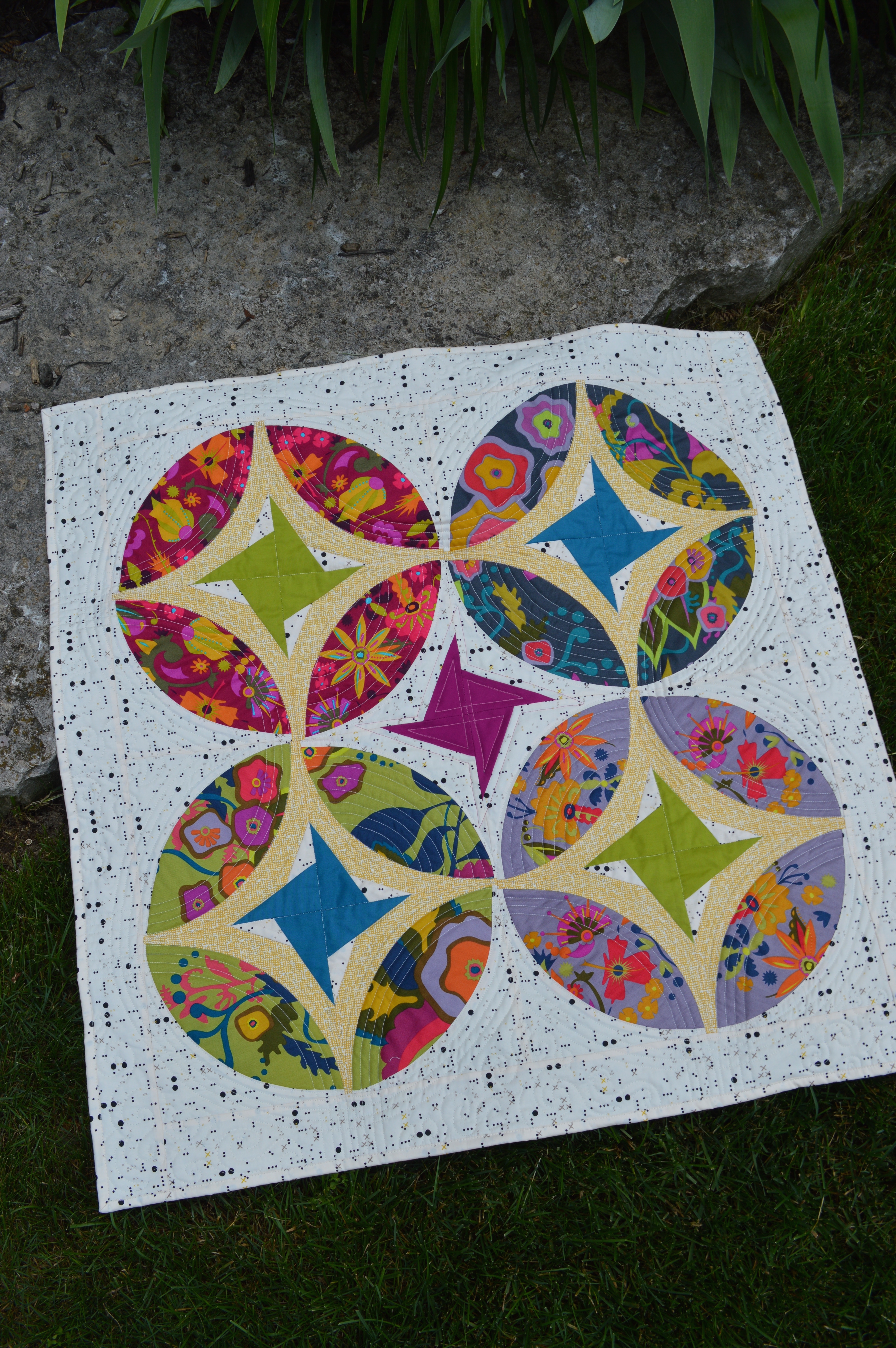 Eclipse quilt pattern, curved piecing mini quilt by Sharon McConnell