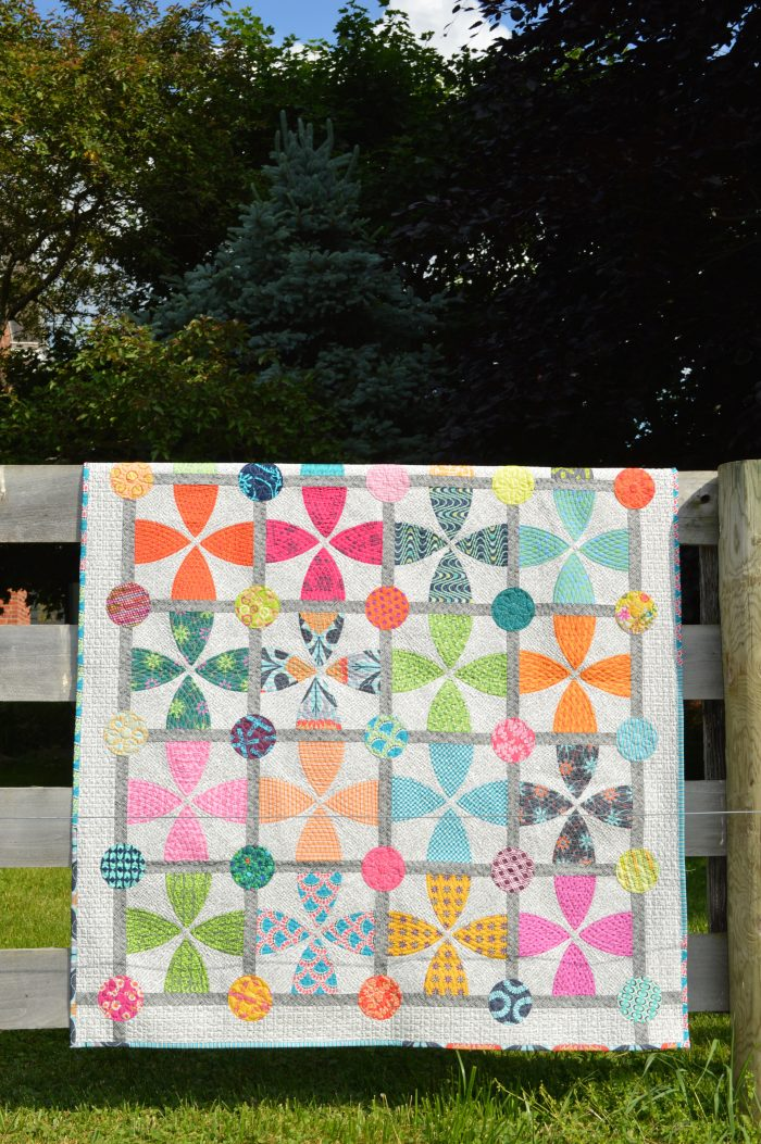 Whimsy garden quilt pattern by color Girl quilts with modern curved piecing and colorful fabrics