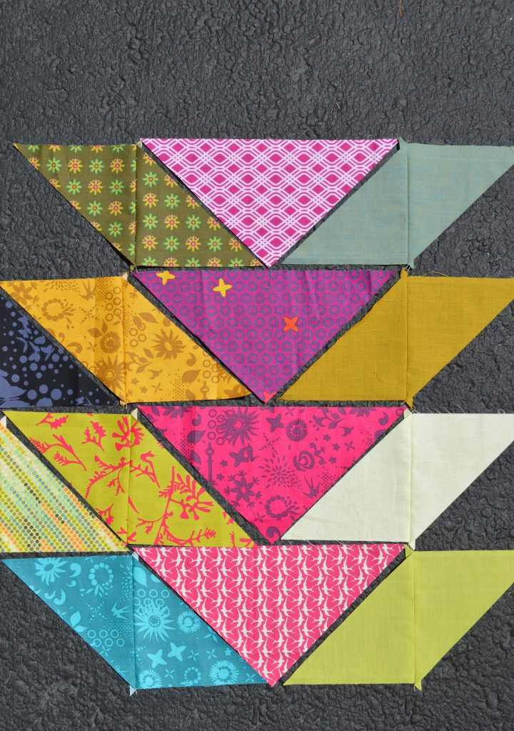 Broken V quilt pattern with triangles, in Alison Glass fabrics