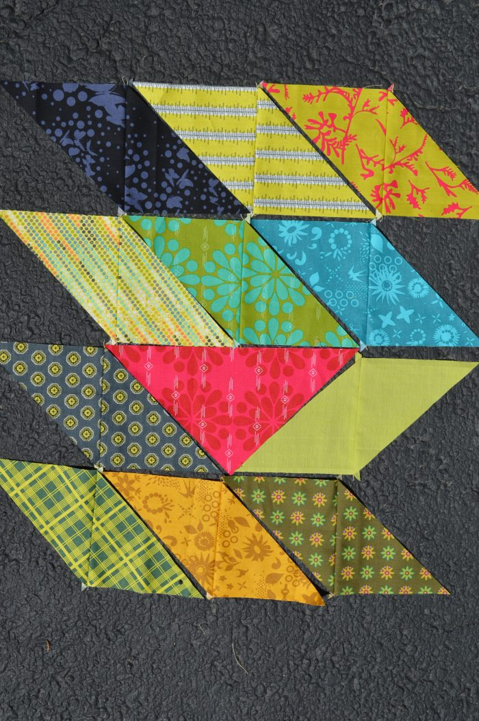scrappy triangle quilt with Alison Glass fabrics