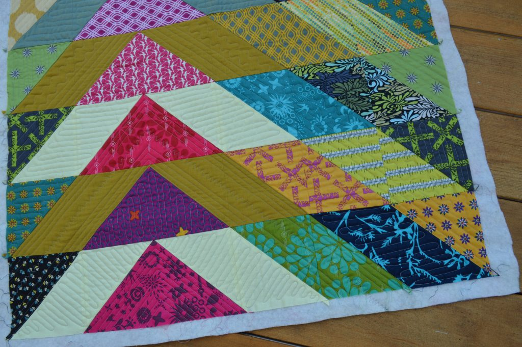 broken v modern triangle patchwork quilt by Sharon McConnell