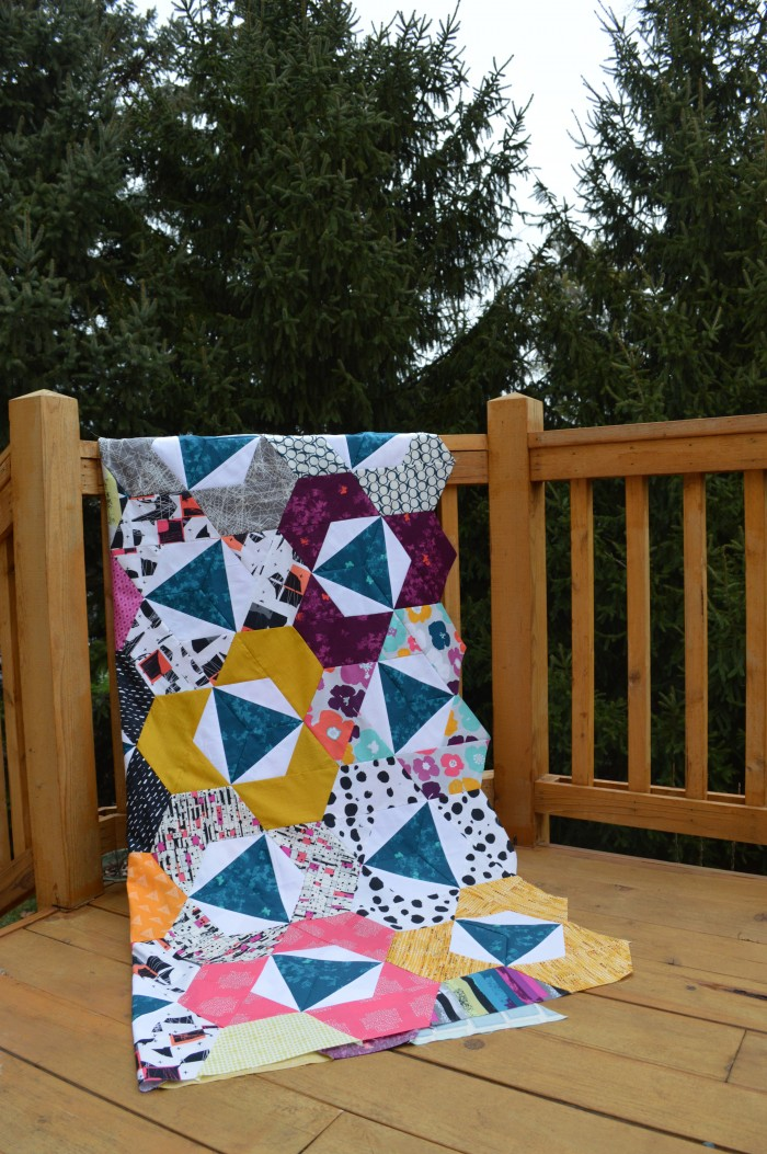 Pieced modern hexagon quilt by Sharon McConnell with Art Gallery Fabrics