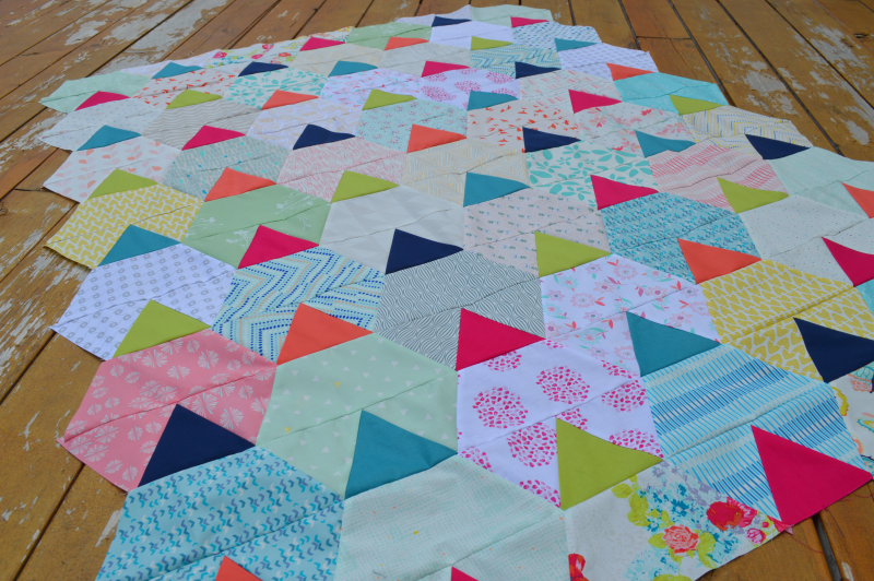 Festival quilt pattern, scrappy modern patchwork quilt by Sharon McConnell