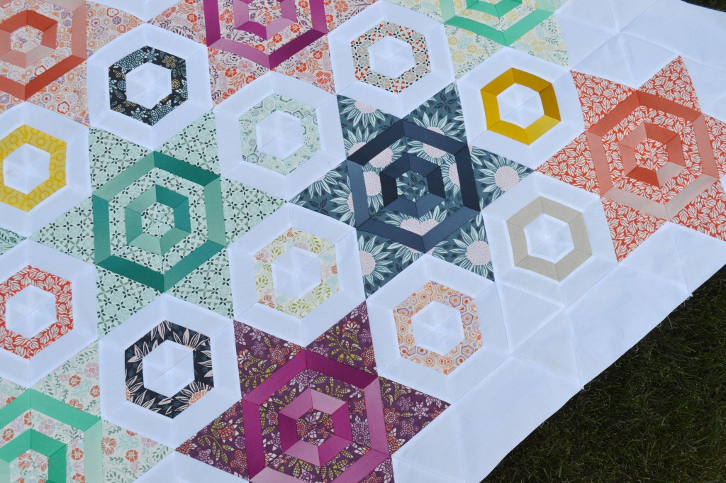 Hexagons and stars quilt by Sharon McConnell with Moda Fabrics by Kate Spain