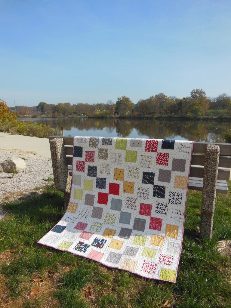 Reflections charm square quilt with fabric by Moda