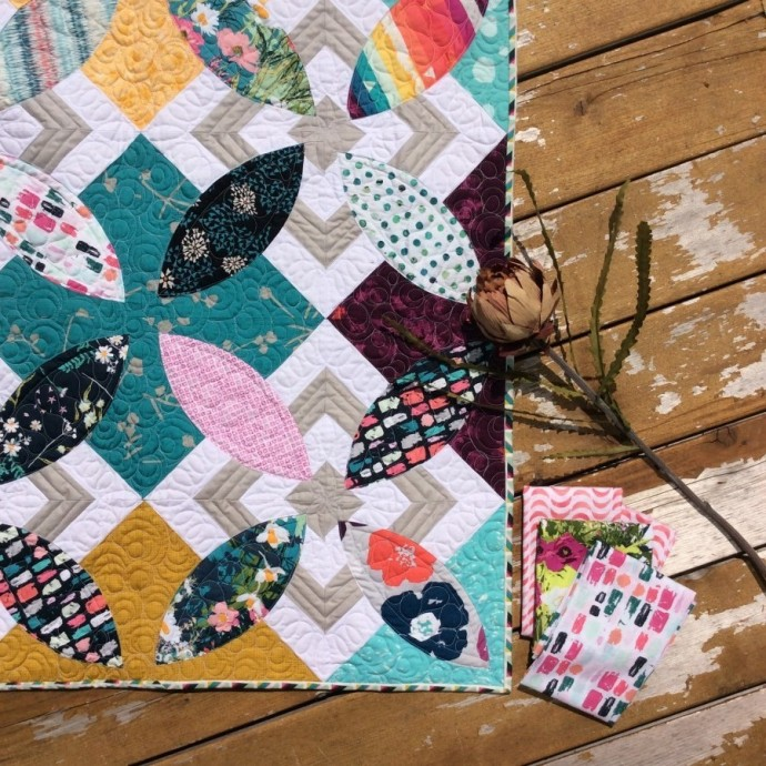Summer Bloom quilt pattern by Color Girl Sharon McConnell. modern curved piecing quilt with Art Gallery Fabrics