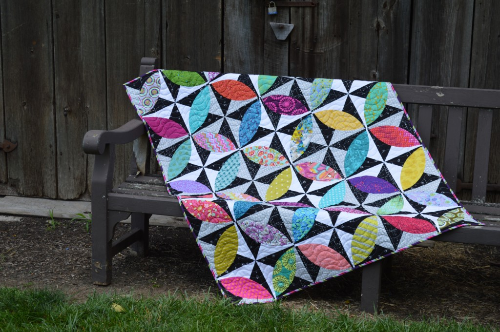 Lava beach quilt by Sharon McConnell, modern curved piecing orange peel quilt