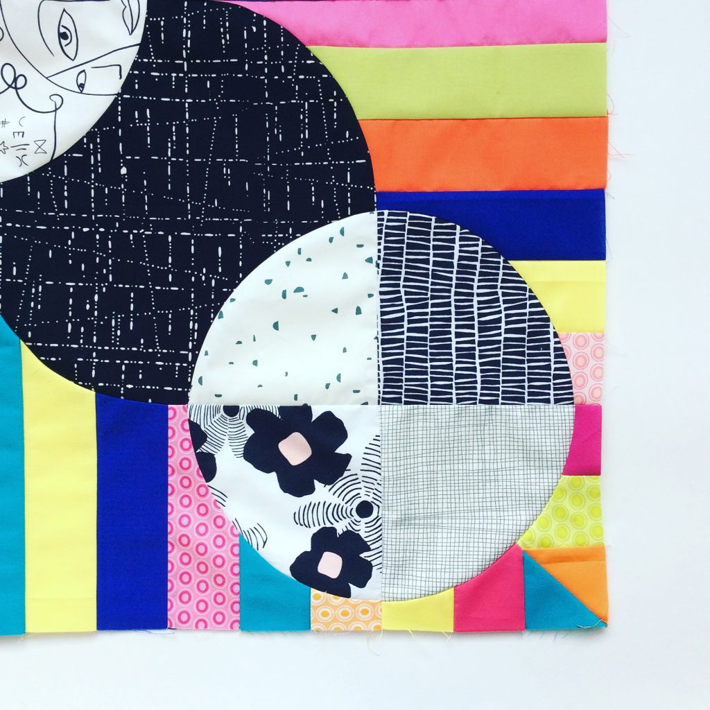 Color stripe curved piecing quilt by Sharon McConnell