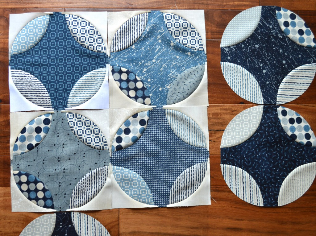 blue and white curved piecing quilt by Sharon McConnell