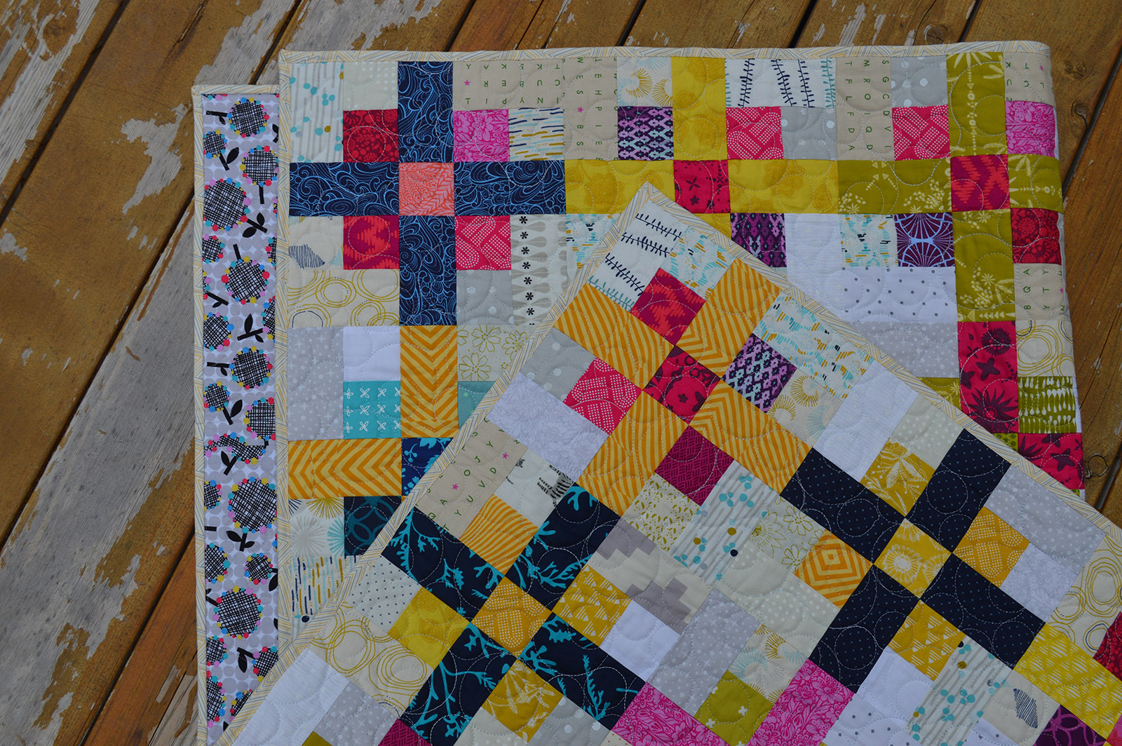 Nine Plus quilt by Sharon McConnell, scrappy modern nine-patch quilt