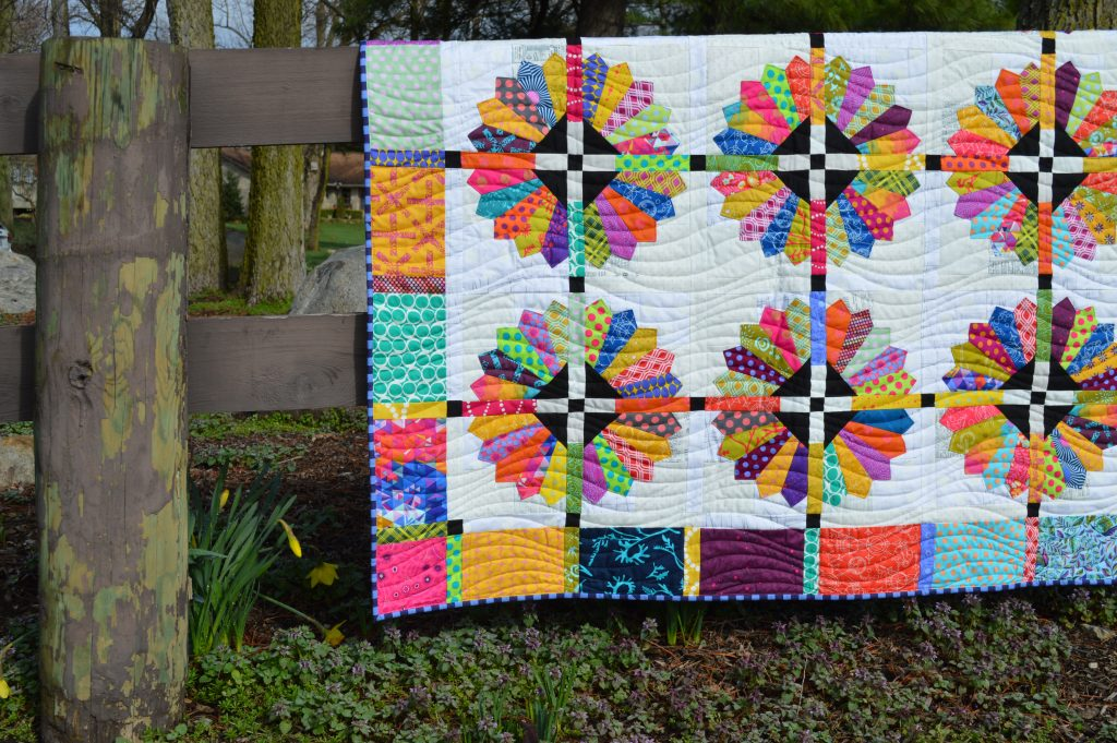 Daisy quilt pattern by Sharon McConnell, modern dresden scrappy bright quilt