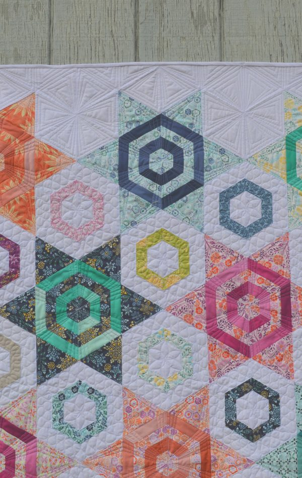 Aurora Quilt, hexagon star pattern by color girl sharon mcconnell, with fabrics by Kate Spain for Moda fabrics