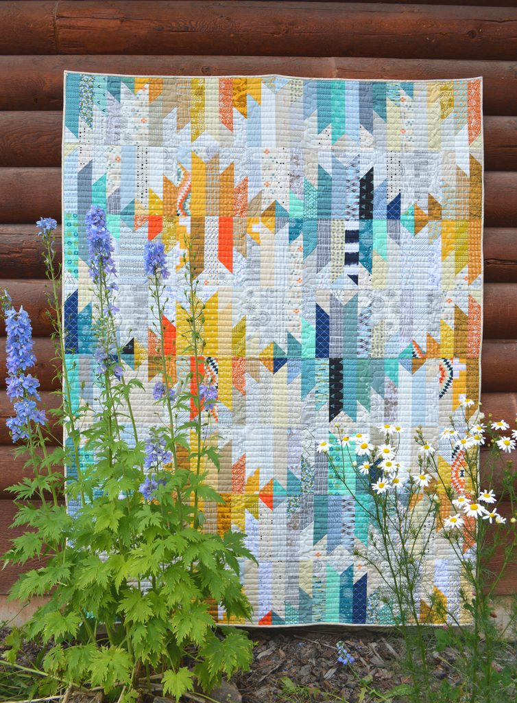 wavelength quilt by Sharon McConnell in American Patchwork and Quilting magazine, modern quilt with strips and scraps