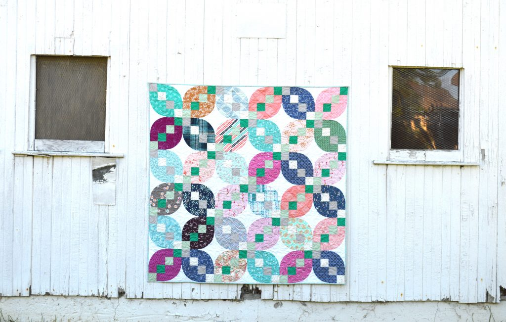 four patch petals quilt by Sharon McConnell in Quilts and More magazine with Art Gallery Fabrics