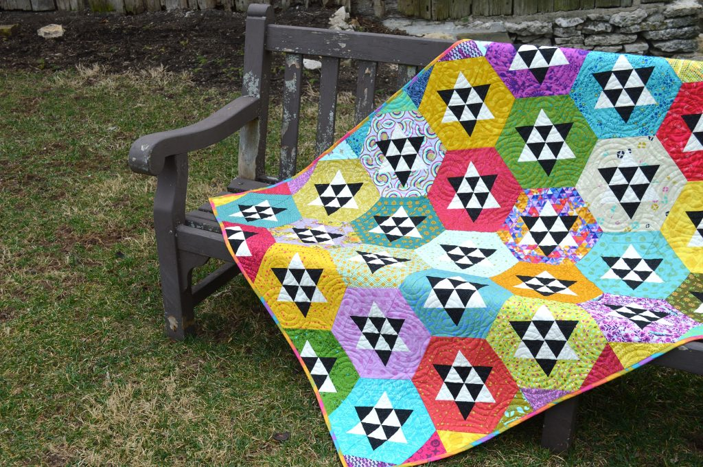 Hexagon and star quilt by Sharon McConnell in Modern Quilts Unlimited Magazine