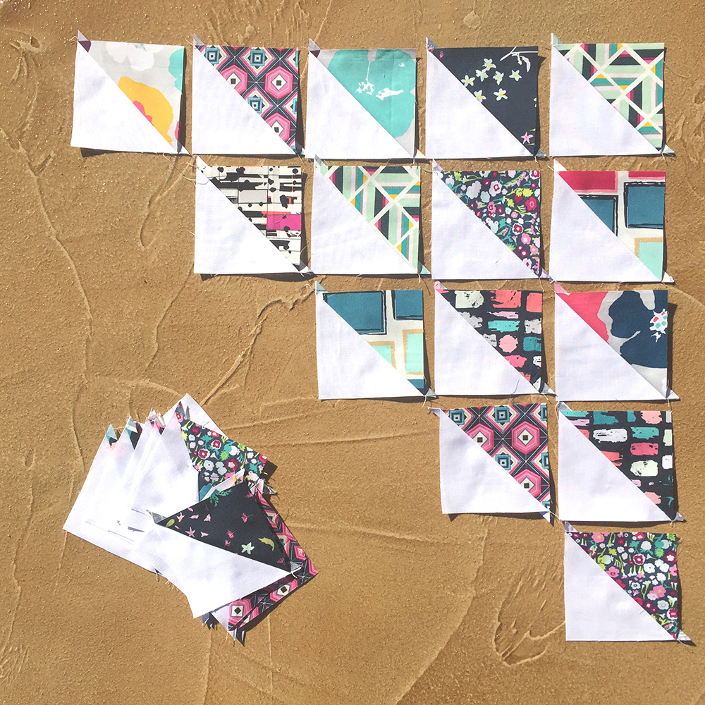 Half square triangle blocks with Art Gallery Fabrics for Pixie Medallion quilt along