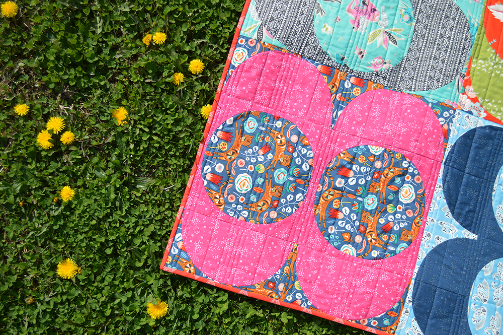Tallinn fabrics by Art Gallery Fabrics, quilt with curved piecing by Sharon McConnell Color Girl quilts