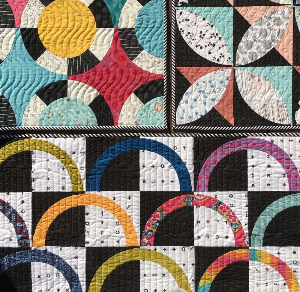 black and white quilts with bright colors by Sharon McConnell colorgirlquilts.com modern quilts with curved piecing