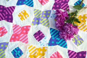 Pom Pom quilt by Sharon McConnell using Tula Pink polka dots and stripes fabrics