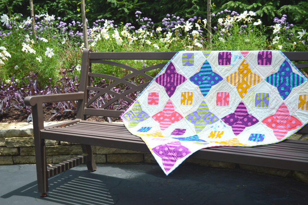 PomPom quilt by Sharon McConnell, Color Girl Quilts with the Classic curves Ruler and Tula pink fabrics
