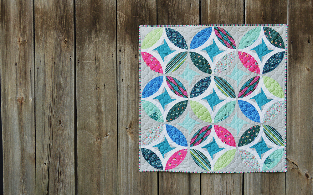 Eclipse quilt by Color Girl Quilts, with the Classic curves Ruler and Art Gallery Fabrics.