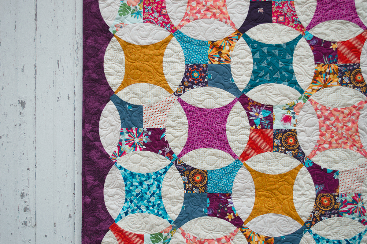 Bloom Quilt, modern flowering snowball quilt by Color Girl Quilts with Aura fabrics
