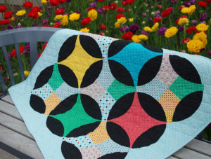 Bloom Quilt with Uppercase Fabrics pattern by Color Girl Quilts for the Classic Curves Ruler