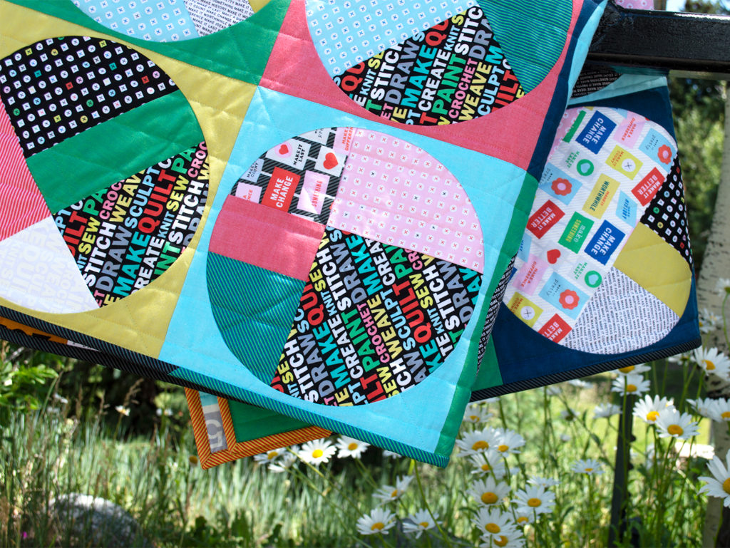 Uppercase fabrics by Windham Fabrics, scrappy circles quilt by Sharon McConnell
